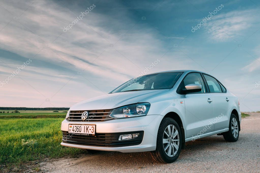 VW Volkswagen Polo Vento Sedan Car Parking In Field Near Country