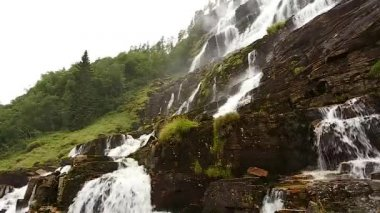 Waterfall Valley, Norway. Waterfall Tvindefossen Is Largest And Highest Waterfall Of Norway, Its Height Is 152 M. Famous Landmark