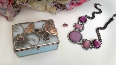 Jewelry box and necklace on the table.