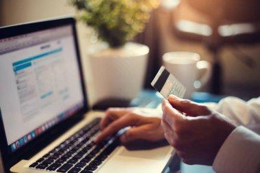 Businessman using credit card online