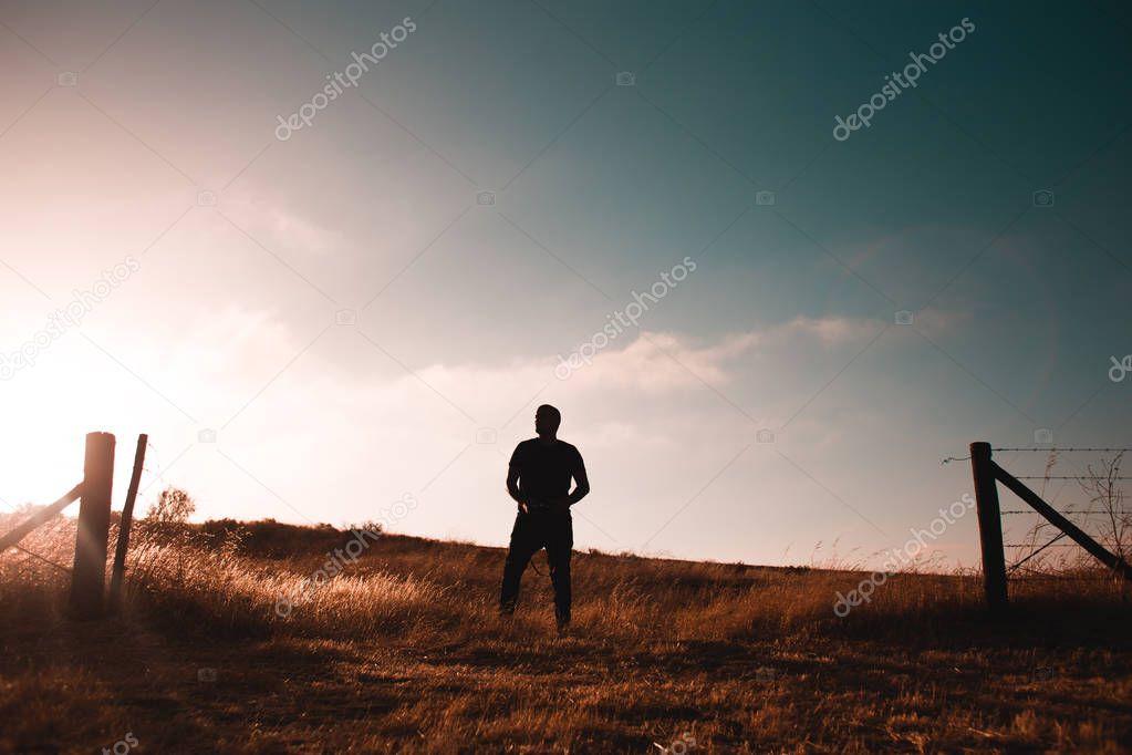 Guy standing in wheat field