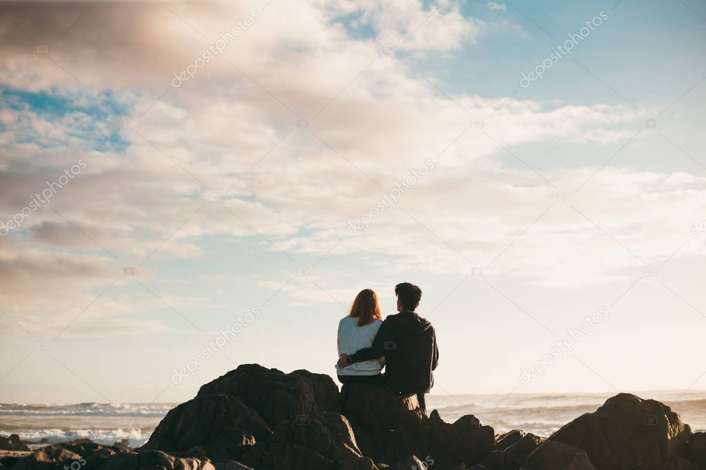 Young couple at the sea shore