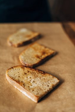 Toasted bread on parchment paper