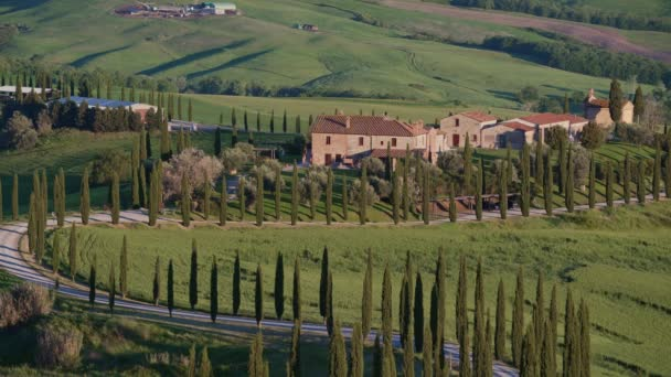 Beautiful spring landscape, view with cypresses road and Italian houses, Tuscany