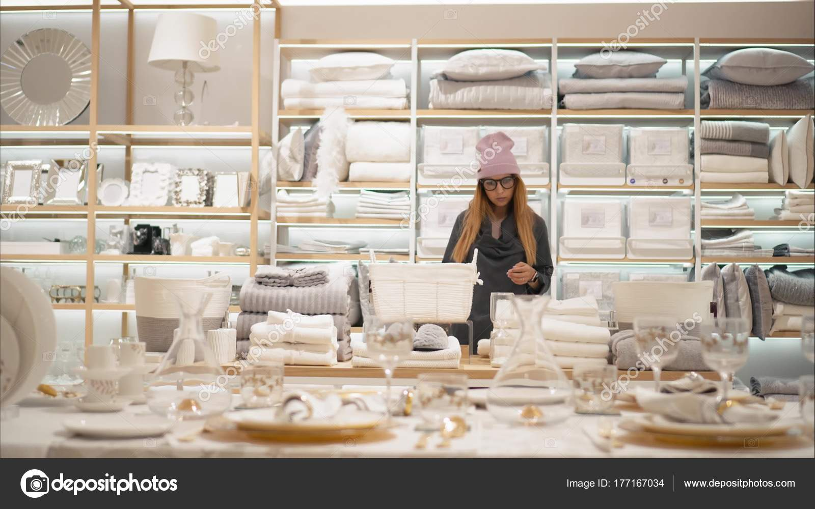 a young hipster female in fashion glasses chooses dishes in the store shopping photo by bwbirdsyahoocom