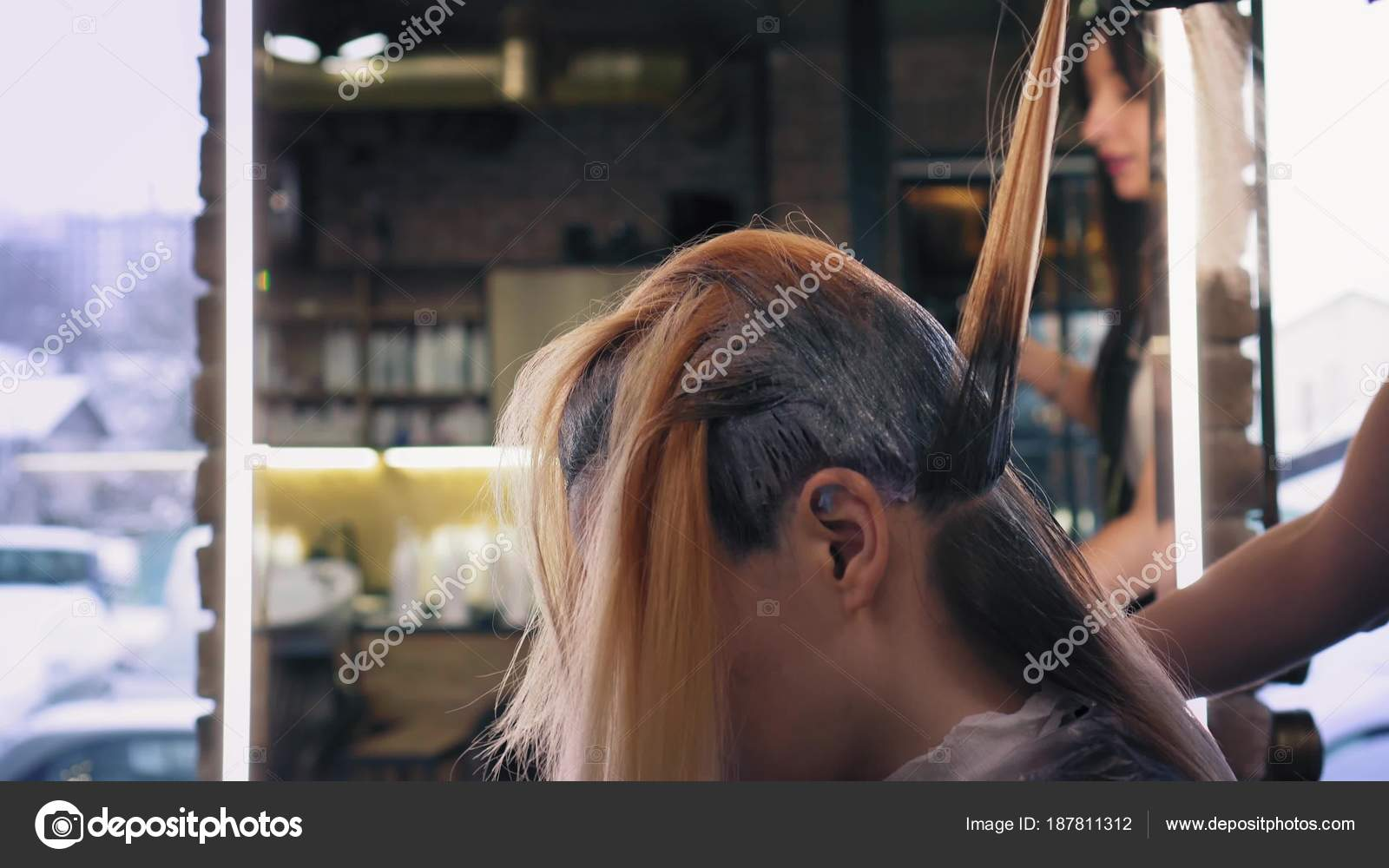 Hairdresser In Black Professional Gloves Applies Hair Dye On Long