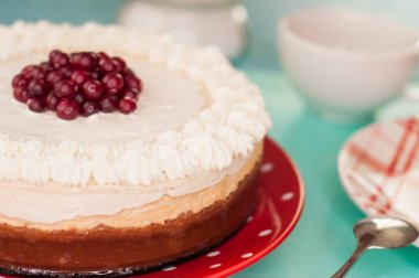 Delicate cheesecake with cranberries, whipped cream