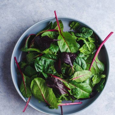 chard salad in a blue bowl top view