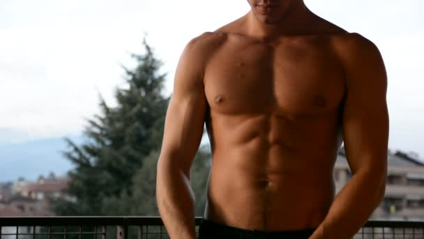 Attractive muscular young man dressing