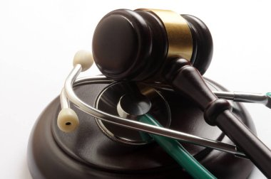 Close up on stethoscope and wooden hammer