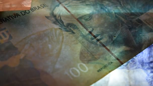 Close up of the Brazilian currency in transparency