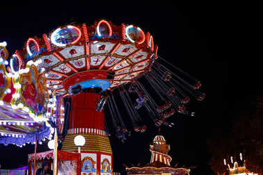 LONDON, UNITED KINGDOM - DECEMBER 13, 2016: Carousel ride at night in Winter Wonderland themed amusement park in London, England. The park returns to London for 11th consecutive year in 2017. stock vector