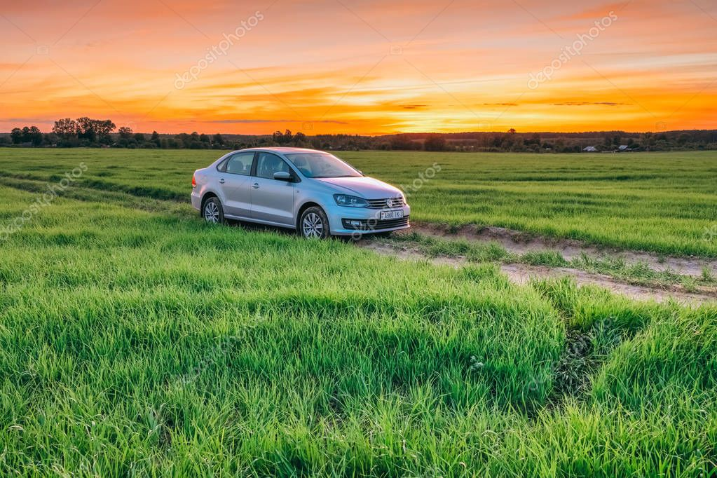 Summer landscape at sunset with Volkswagen Polo Vento machine in