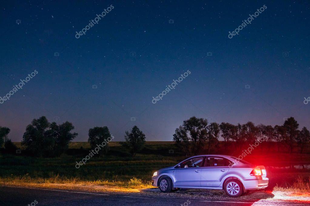 Volkswagen Polo Vento on the roadside at night. Dobrush, Belarus