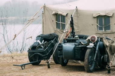 German motorcycle of the Second World War and an infantry cart