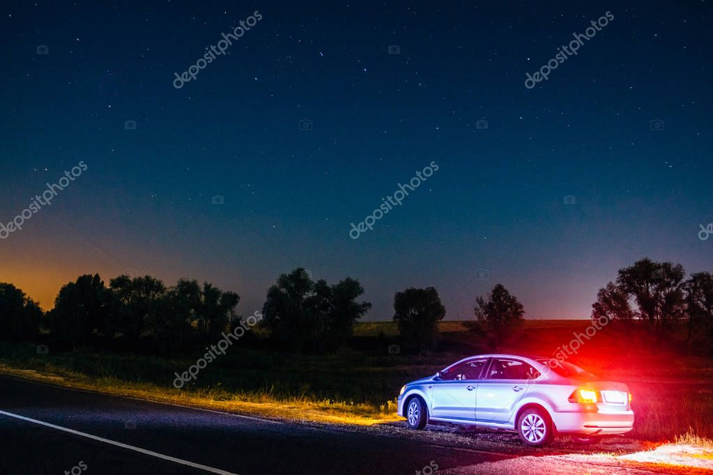 Volkswagen Polo at night on the roadside under the starry sky. D