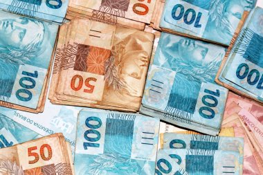 Brazilian money packages with 50 and 100 reais notes