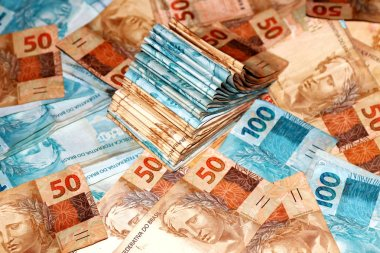 Cash package with 100 reais notes from Brazil