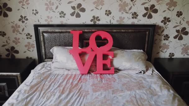 Valentines day background. Red letters love on bed for valentines day and christmas.