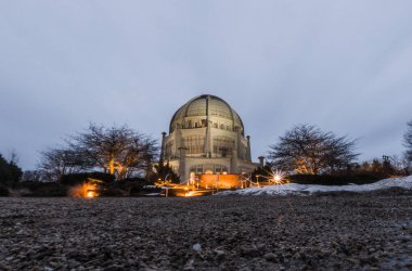 Wilmette, IL - February 19, 2018: The Bahai house of worship temple stands firm as storm clouds pass overhead as evening sets in on Monday.