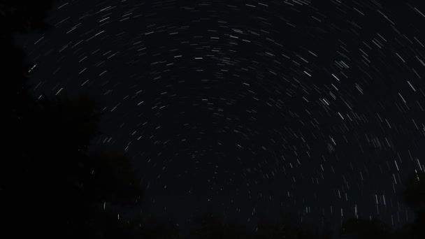A cumulative or continuous star trail time lapse of the dark night sky in Wisconsin with stars creating a circular pattern about a center point.