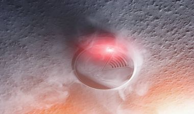 smoke detector with white smoke and red warning light