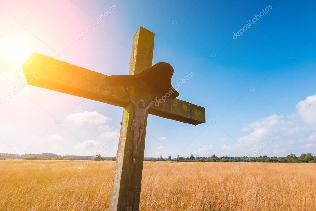 wooden cross religion symbol at a hiking trail in Belgium, Hohes