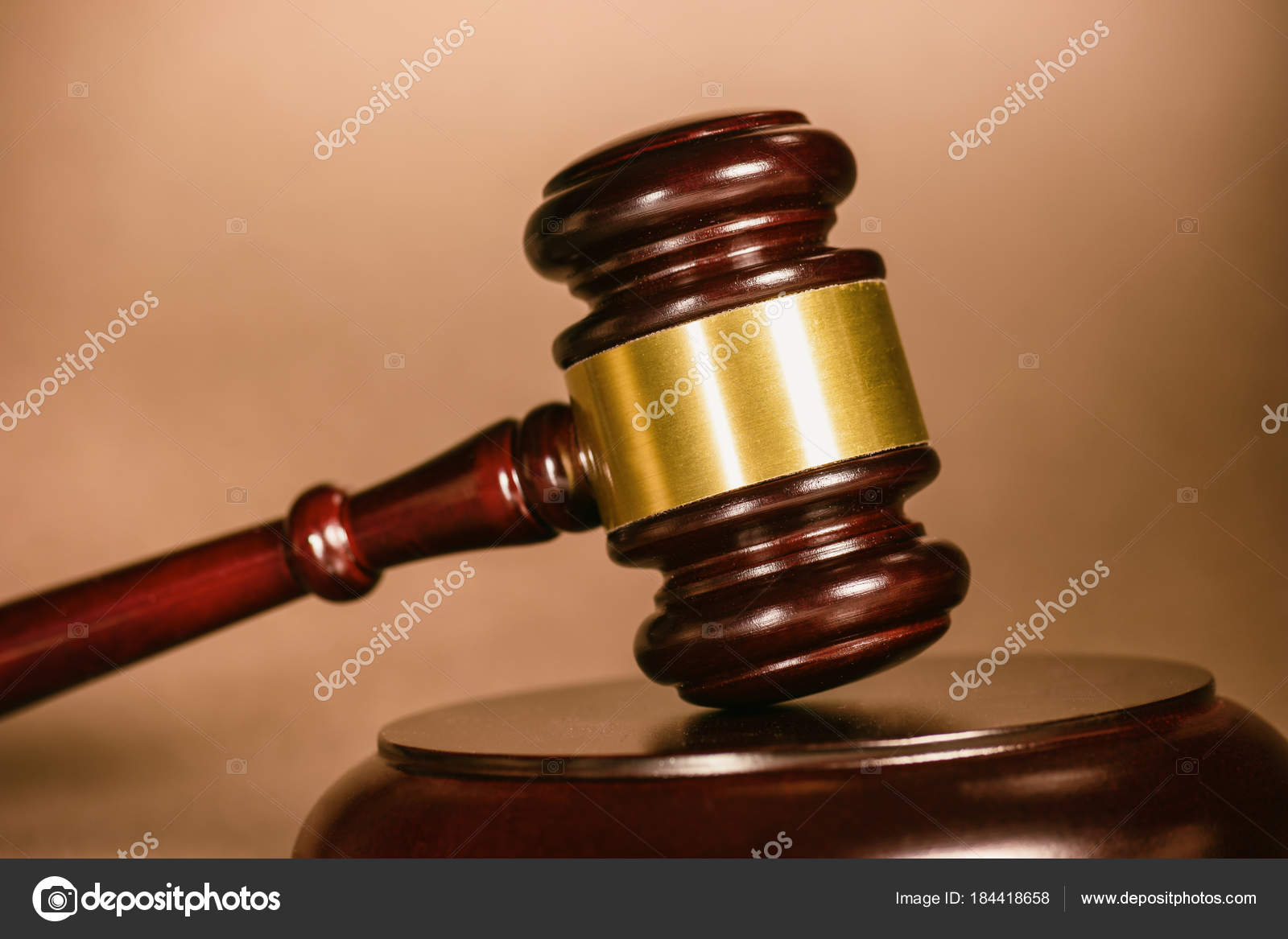 A Judge Gavel On Table Against Brown Background Ideal For Websites And Magazines Layouts Photo By