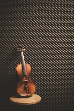 Classical violin on acoustic board background in recording studio