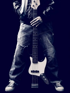 Male musician holding electric bass guitar