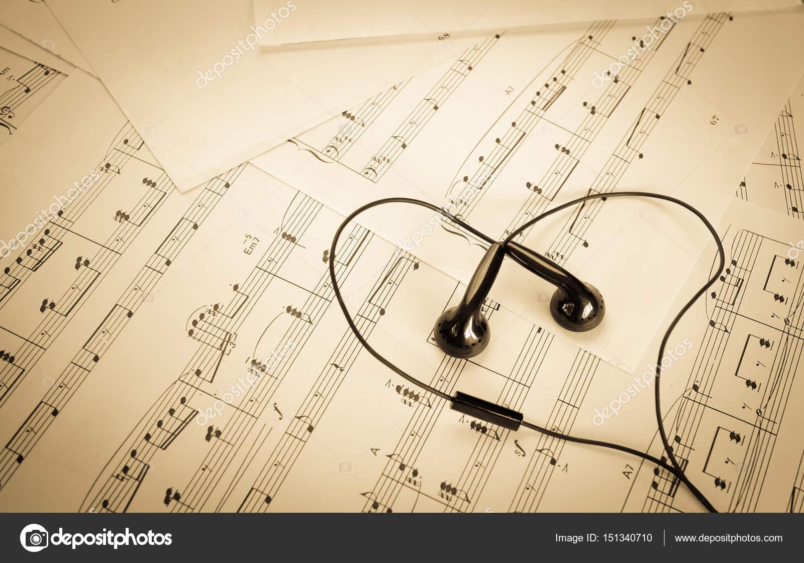 Earphone on music sheet look like heart stock photo princeoflove earphone on music sheet look like heart stock photo ccuart Image collections