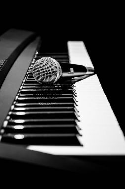 microphone on piano, black and white. music background