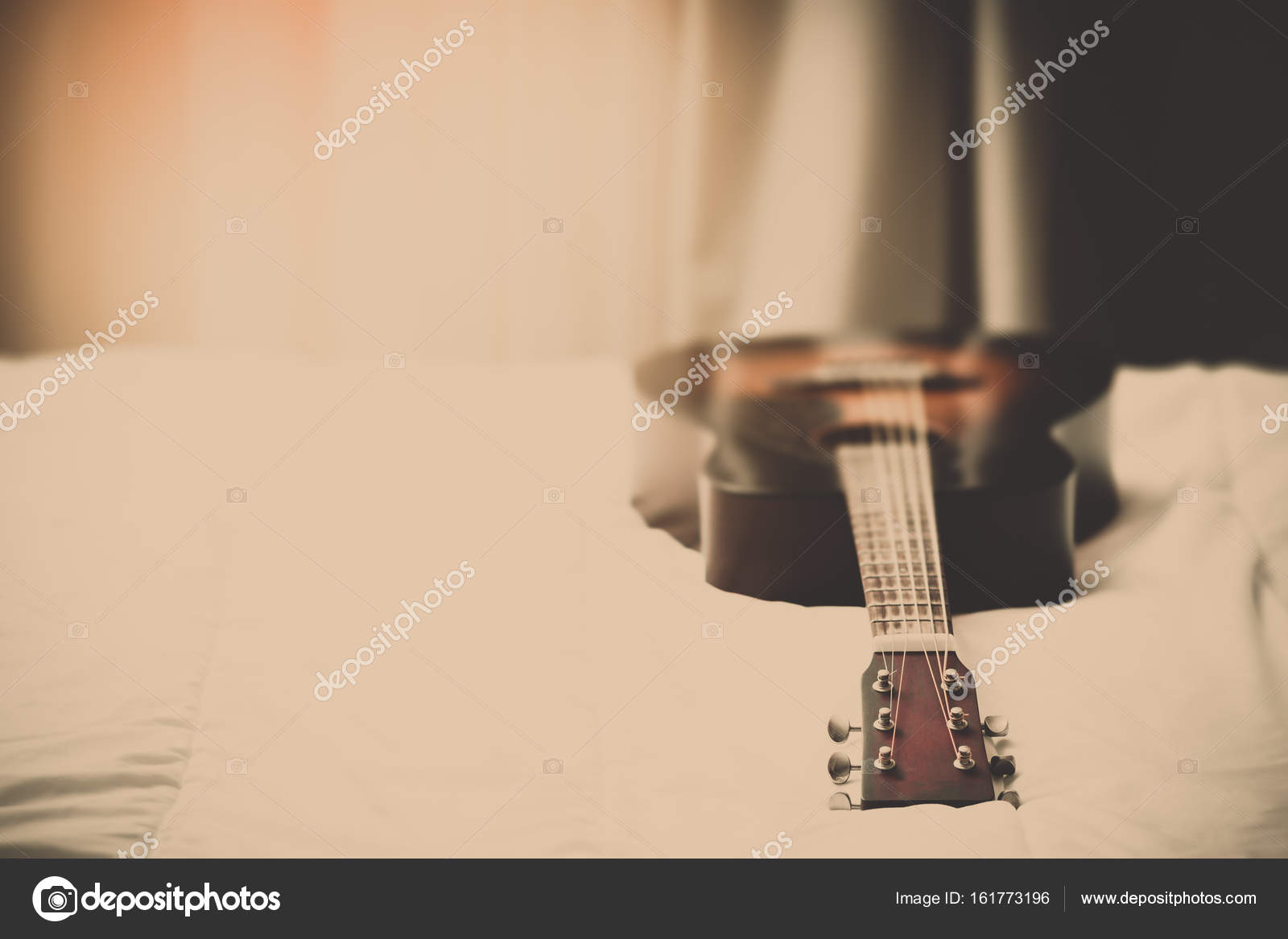 Acoustic Guitar On Bed In The Morning Vintage Filter Stock Photo
