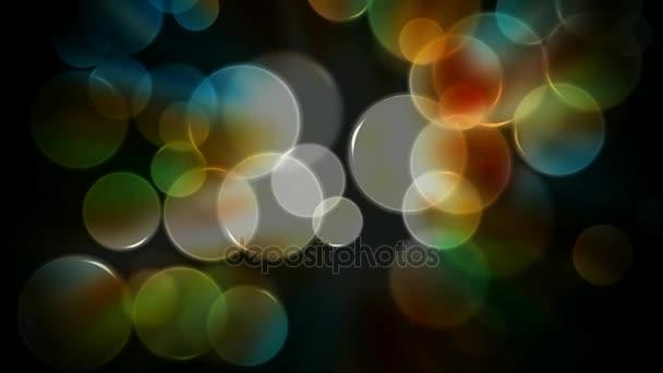 verschwommen glühenden bunten Bokeh Lichter nahtlose Schleife Hintergrund. bunte Kreise Video-Hintergrund-Schleife / / / glasige kreisförmige Formen. Bewegungsabstrakt