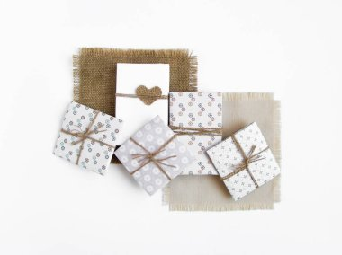 Rustic handmade gift boxes on white background. Top view, flat lay