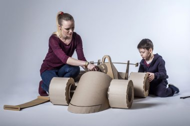 Cardboard racing car and happy family