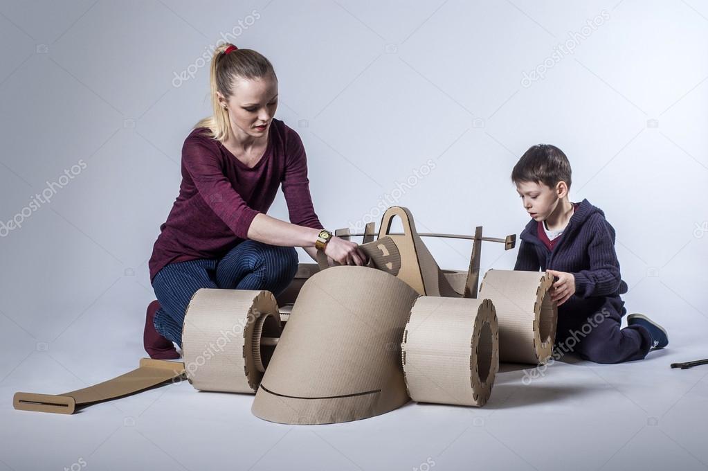 Cardboard racing car and happy family