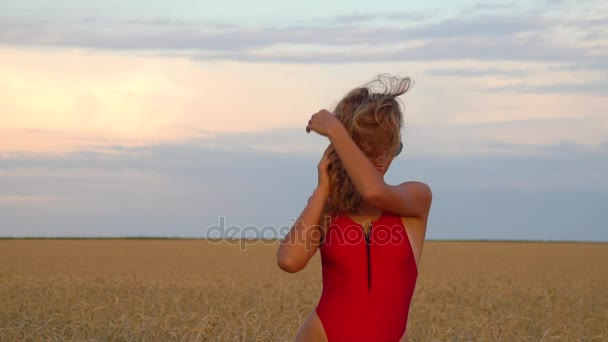 Girl in a field in a red swimsuit. Slowmo 120fps