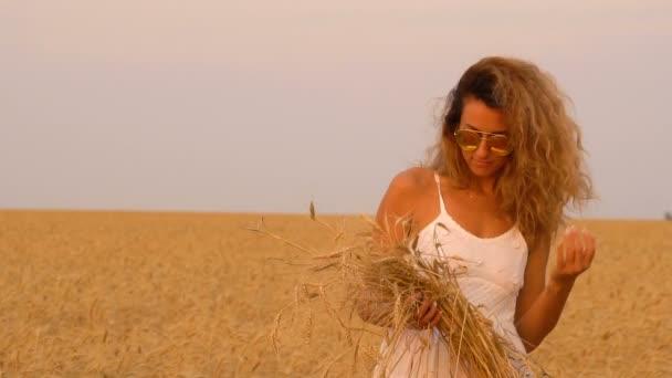 Beautiful girl in a field in a white dress. Slowmo 120fps