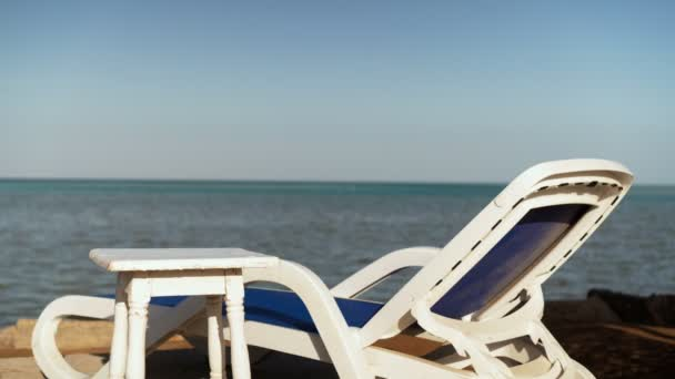 Chair longue at perfect wild sandy beach with turquoise sea view, nobody, travel destinations concept