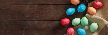 """Картина, постер, плакат, фотообои """"натюрморт пасхальных яиц в птичьем гнезде на деревянном фоне. сельский. пасхальное празднование. принято. плоский лежал. баннер ."""", артикул 355875458"""