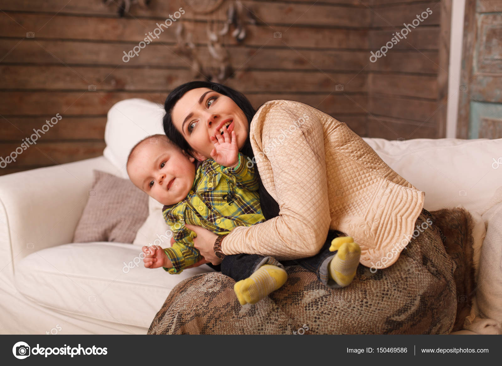 Mother Hugging Her Son The Child Poses A Funny Face Cute Little