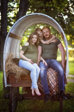 the couple in the wagon