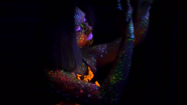 Portrait of Beautiful Woman with Purple Hair Dancing with Neon UV Light  Lamp  Model Girl with Fluorescent Creative Psychedelic MakeUp, Art Design  of Female Disco Dancer Model in UV