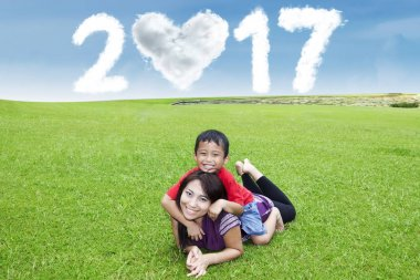 Mother and son at field with 2017