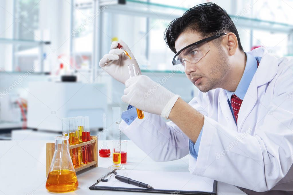 Smart chemist doing chemical test in lab — Stock Photo ...