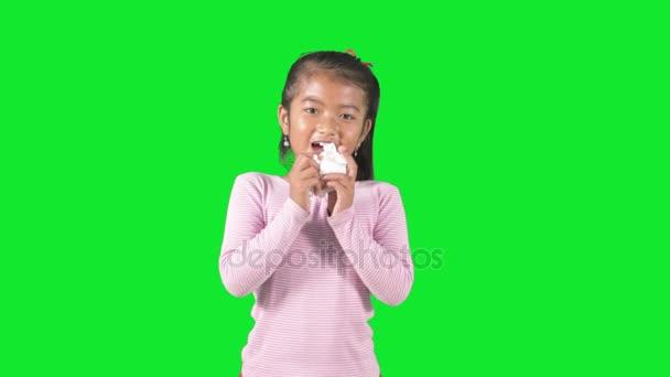 Sick child sneezing in studio