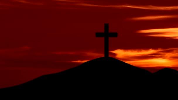 Christian kereszt szimbólumot a hegyen napkeltekor
