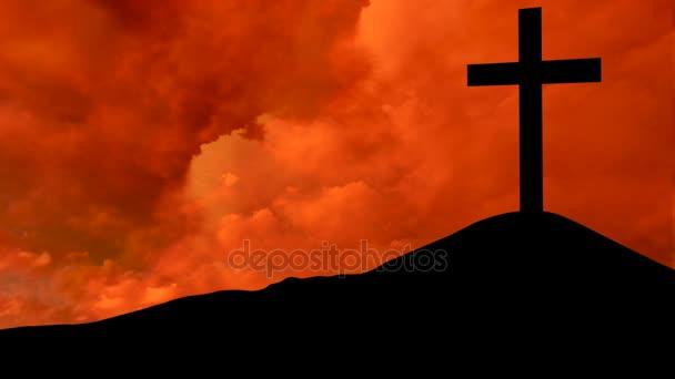 Křesťanský kříž s červenými cloud na západ slunce
