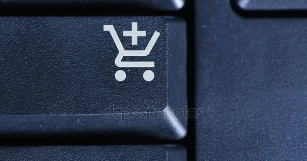 Finger pushing a shopping cart button